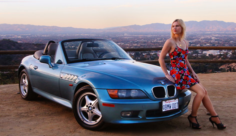 Athena Stamos and her BMW Z3 with James Bond 007 licence plate