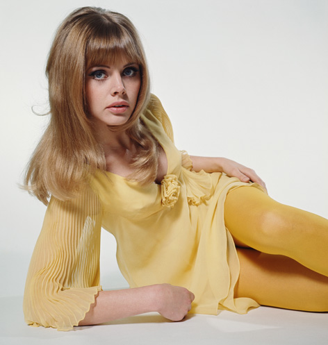 Swedish actress Britt Ekland yellow dress matching tights circa 1964