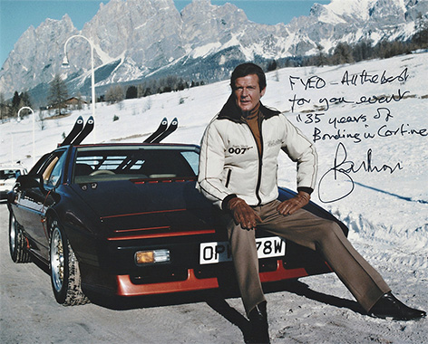 Roger Moore signed photo Lotus Esprit Cortina
