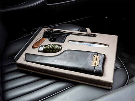 Aston Martin DB5 Goldfinger Thunderball auction RM Sothebys gadgets knife rifle