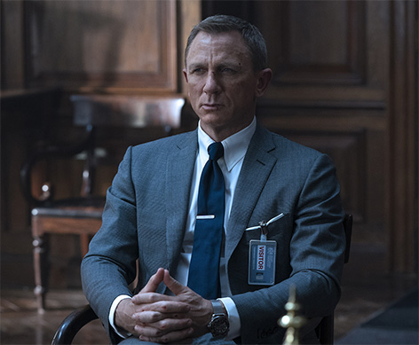 James Bond in TOM FORD Grey Wool Prince of Wales Check O'Connor Notch Lapel Jacket, O'Connor Tailored Trousers, Sea Island Poplin Collared Shirt and Off White Silk Pocket Square