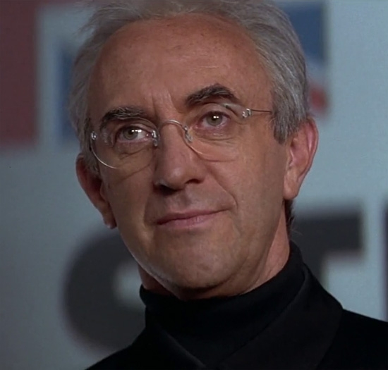 Elliot Carver (Jonathan Pryce) in Tomorrow Never Dies, wearing ...