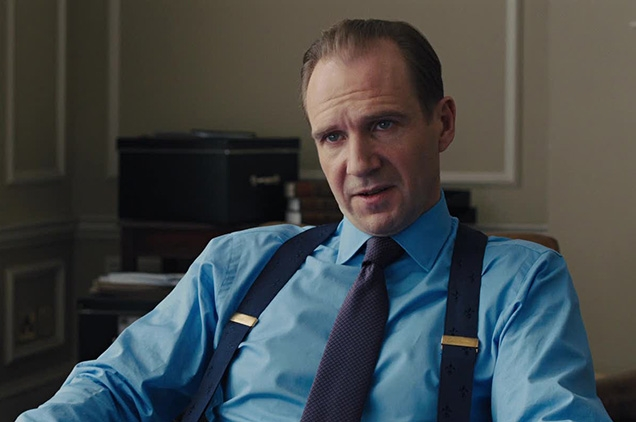 Gareth Mallory (played by Ralph Fiennes) wears a pair of Ede & Ravenscroft Dark Blue Fleur De Lys braces in SkyFall