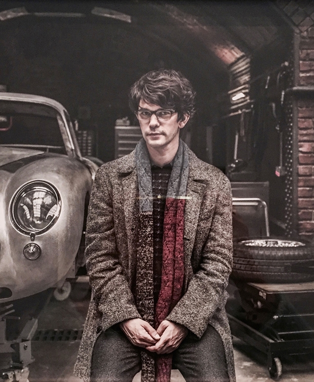 Q (Ben Whishaw) wearing the Billy Reid Astor Coat in a promotional image for SPECTRE
