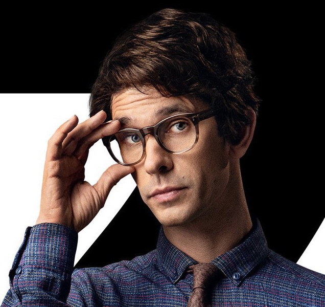 Q (Ben Whishaw) wears Moscot Mensch eyeglasses on this character poster for No Time To Die