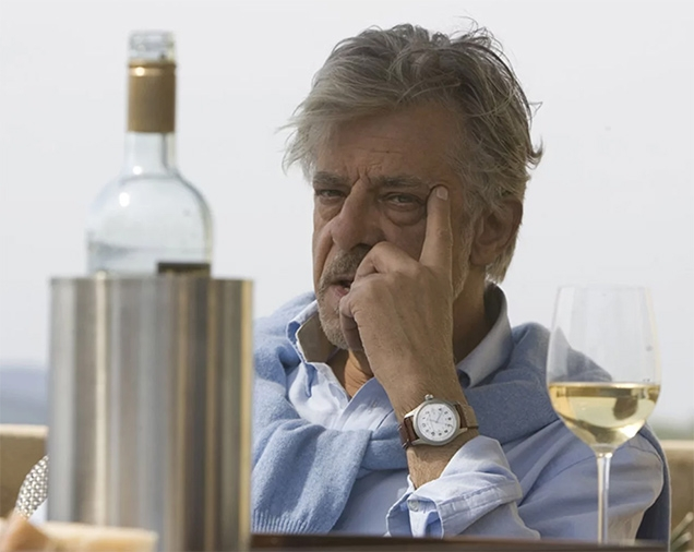 Giancarlo Giannini as René Mathis wearing a Hamilton Khaki Field watch in the movie Quantum of Solace.