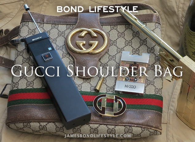 Vintage Gucci Bag, similar to the one used in The Man With The Golden Gun, and other items seen in the film: a Sony walkie talkie, Gucci belt buckle, Solex Agitator, Golden Gun, Dom Pérignon Champagne.