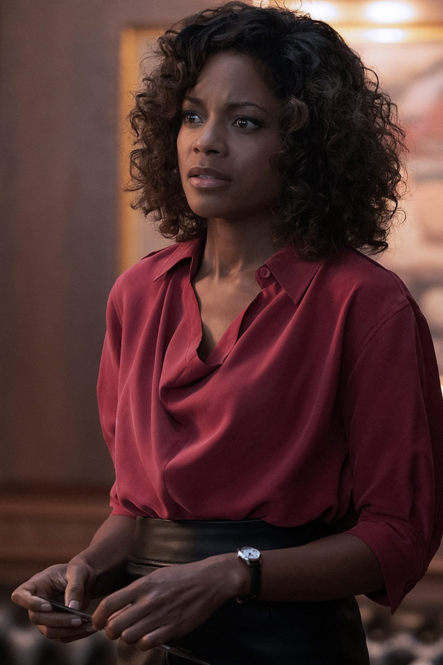 Eve Moneypenny (Naomie Harris) wears a Joseph Murry Fuji silk blouse in No Time To Die