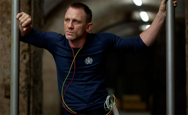 Daniel Craig as James Bond wearing blue training outfit in SkyFall