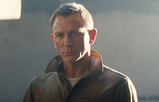 Daniel Craig as James Bond, wearing Rogue Territory Waxed Ridgeline Supply Jacket in No Time To Die