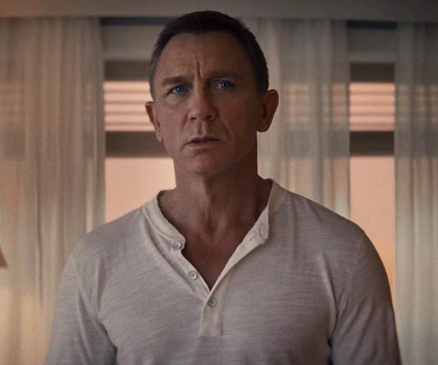 Daniel Craig as James Bond wearing a Rag & Bone Henley shirt in No Time To Die