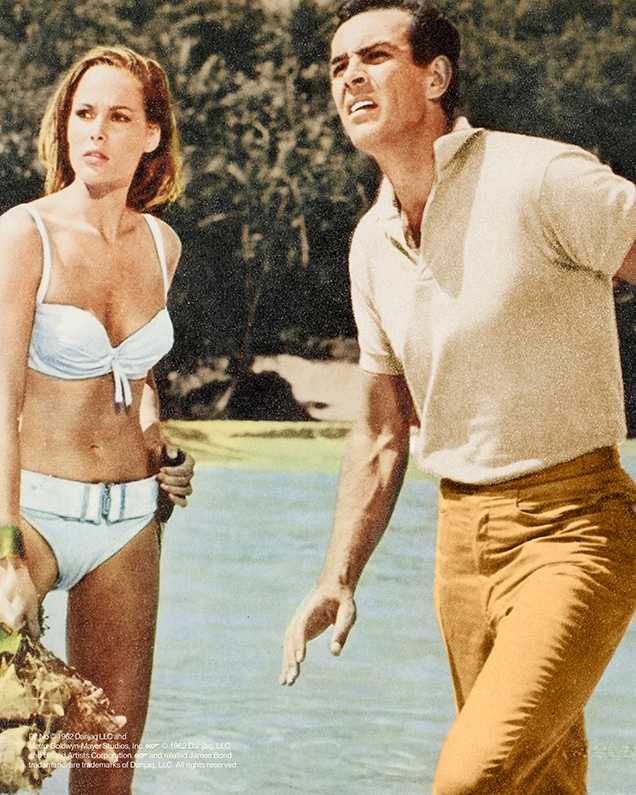 A heavily color-corrected promotional image from Dr No shows an ivory shirt, while the shirt and trousers in the film are blue
