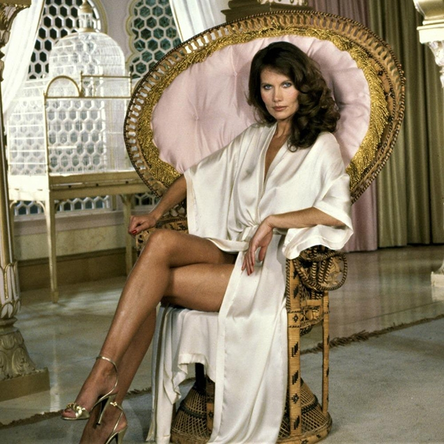 Maud Adams as Octopussy wearing a long silk robe in a promotional photo for the film.