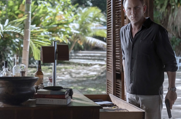 James Bond in his Jamaican home, with a bottle of Blackwell Run on the table.