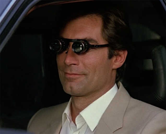 Timothy Dalton as James Bond uses a pair of Binocular Glasses in The Living Daylights