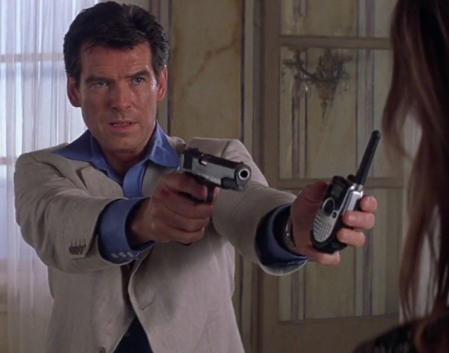 Pierce Brosnan as James Bond hands the Motorola TalkAbout TA280 SLK Two-Way Radio to Elektra King (Sophie Marceau)