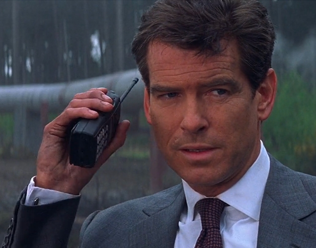 Pierce Brosnan as James Bond uses a Motorola Professional Series two-way radio in The World Is Not Enough