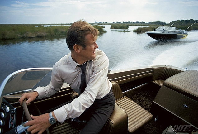 Roger Moore as James Bond wears a Tissot PR-516 watch in Live And Let Die during the speedboat chase