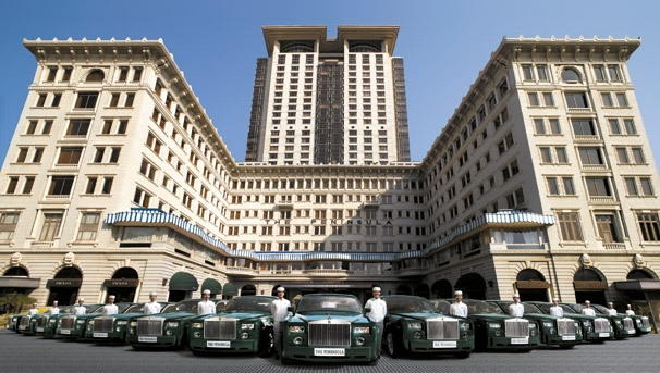 The Peninsula Hong Kong with its fleet of green Rolls Royces. The central tower didn't exist yet at the time of the movie The Man With The Golden Gun (1974).