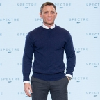 Daniel Craig wears N.Peal sweater, vintage Omega watch and Crockett & Jones shoes at the Bond 24 press conference