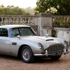 Aston Martin DB9 GT Bond Edition and DB5 at Goodwood Revival
