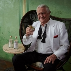 George Lazenby in ad for The Melbourne Gin Company and new audiobook Passport to Oblivion